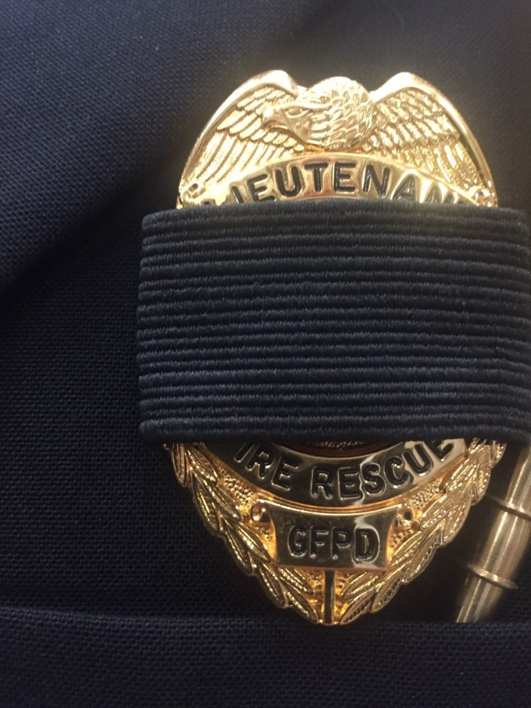 Most of the hundreds of first responders who attended Monday's Tayler Esslinger memorial service shrouded their badges as a sign of honor and mourning for Esslinger.