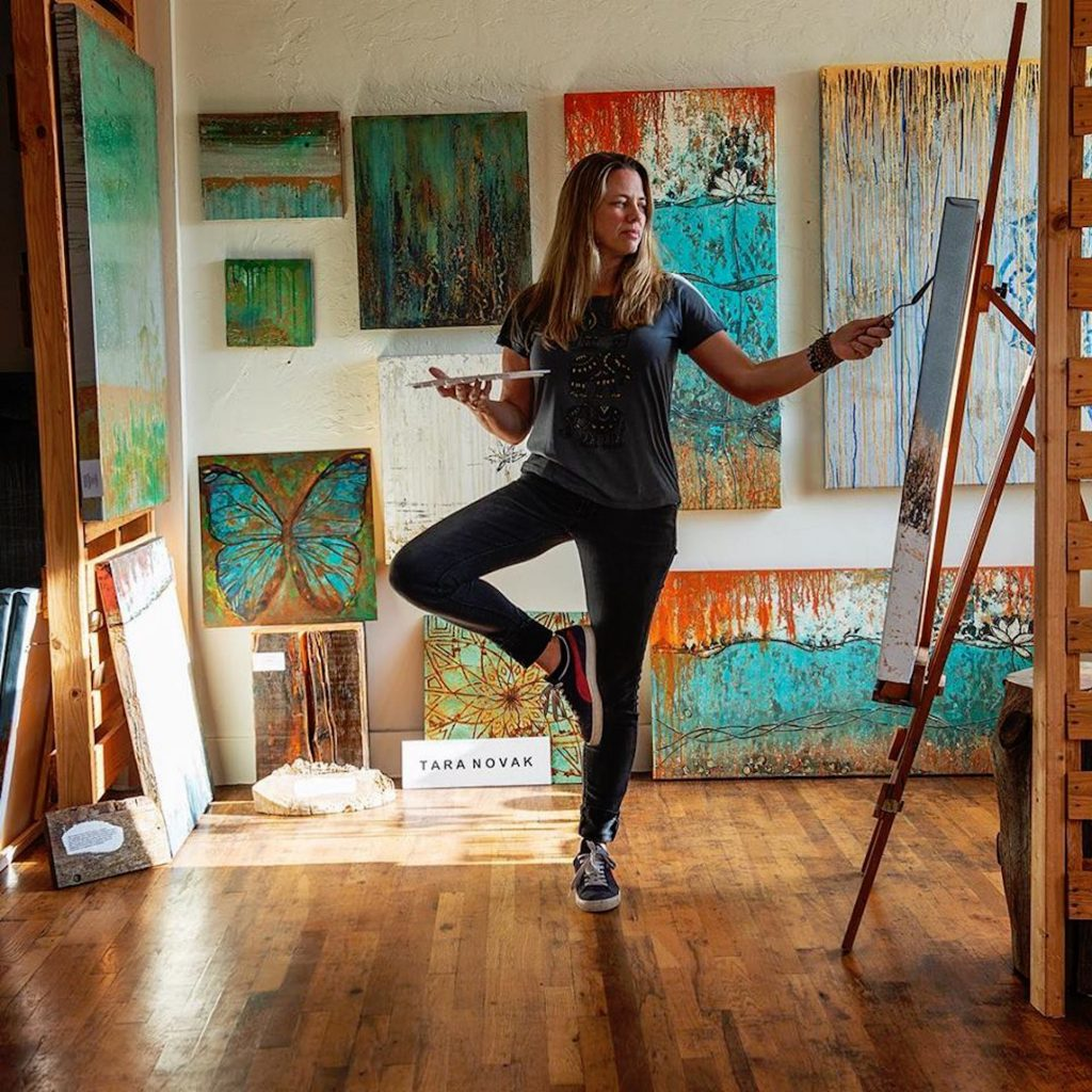 Tara Novak, artist and founder of the Eagle 2nd Friday ARTWalks on Broadway, paints in her studio in Eagle. This Friday is the first ARTWalk since quarantine.