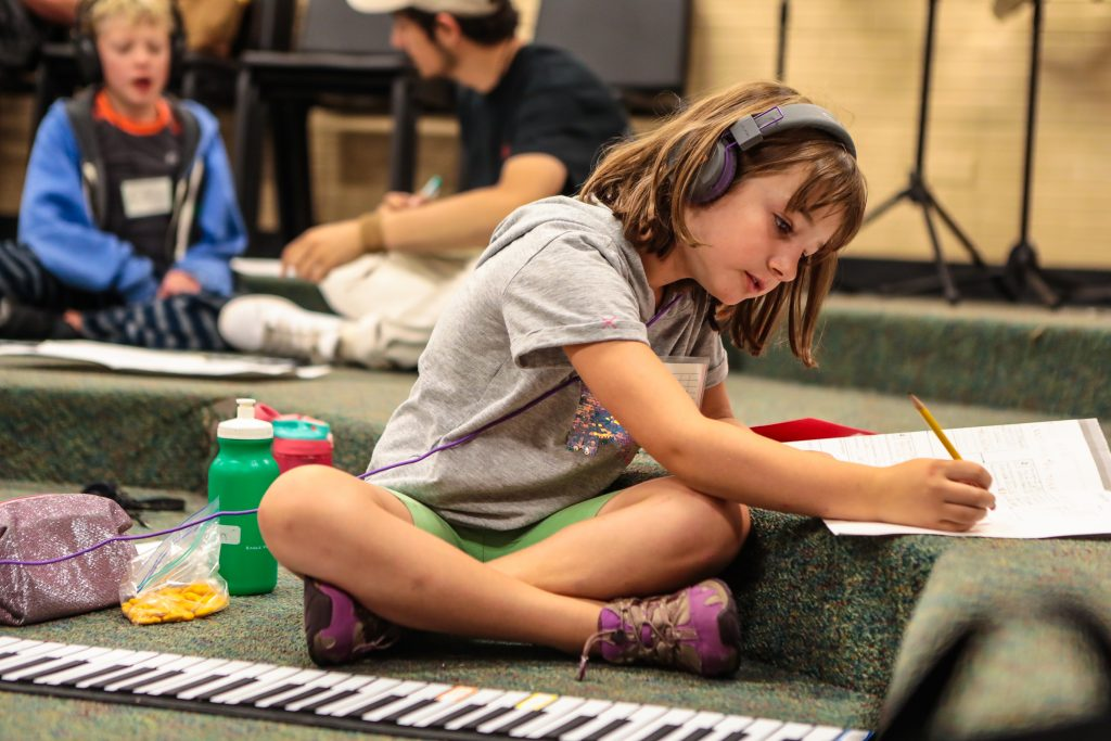 Madelyn Crawford, 8, works on her music during the Very Young Composers program Friday at Homestake School in EagleVail. Kids write their own music and perform it with members of the New York Philharmonic.