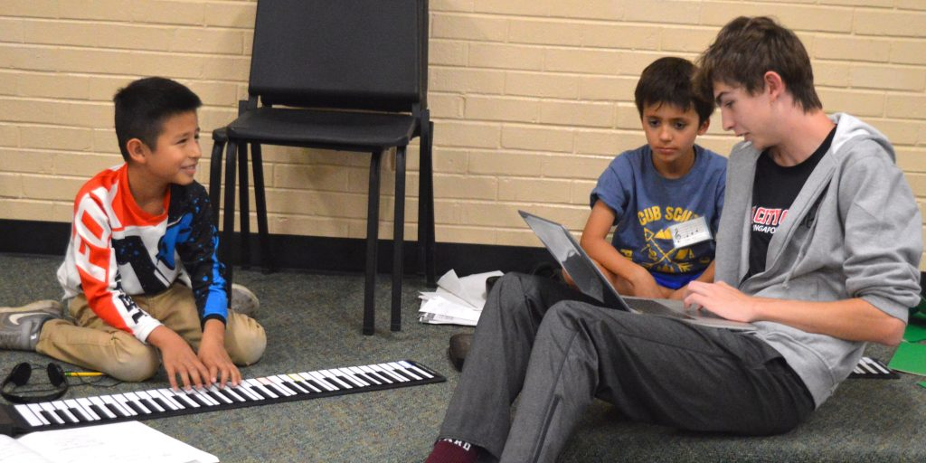 Klip Lester, right, works with Levi Armenta, left, and Tommy Tvarkunas as they work in Friday's session of the Very Young Composers program.