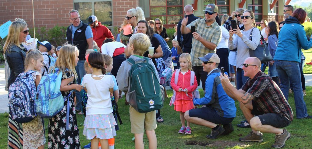 Parents at Brush Creek Elementary School grab some memories as their daughters and sons started classes Monday.