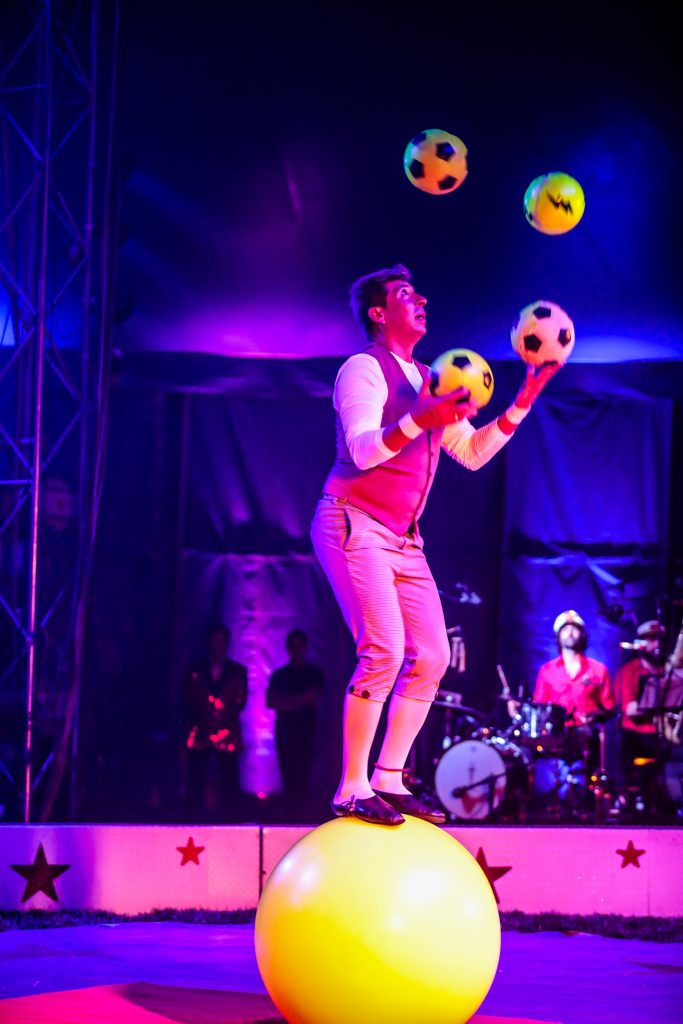 Boris Ojguin juggles three balls on a ball during the Bella Circus opening performance Friday in Avon. The whole show is done to a live band, named the Circus Bella All-Star Band.