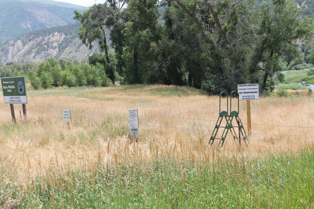 Turnstiles over fencing mark the access points to the Colorado Parks and Wildlife fishing easements east of Eagle.