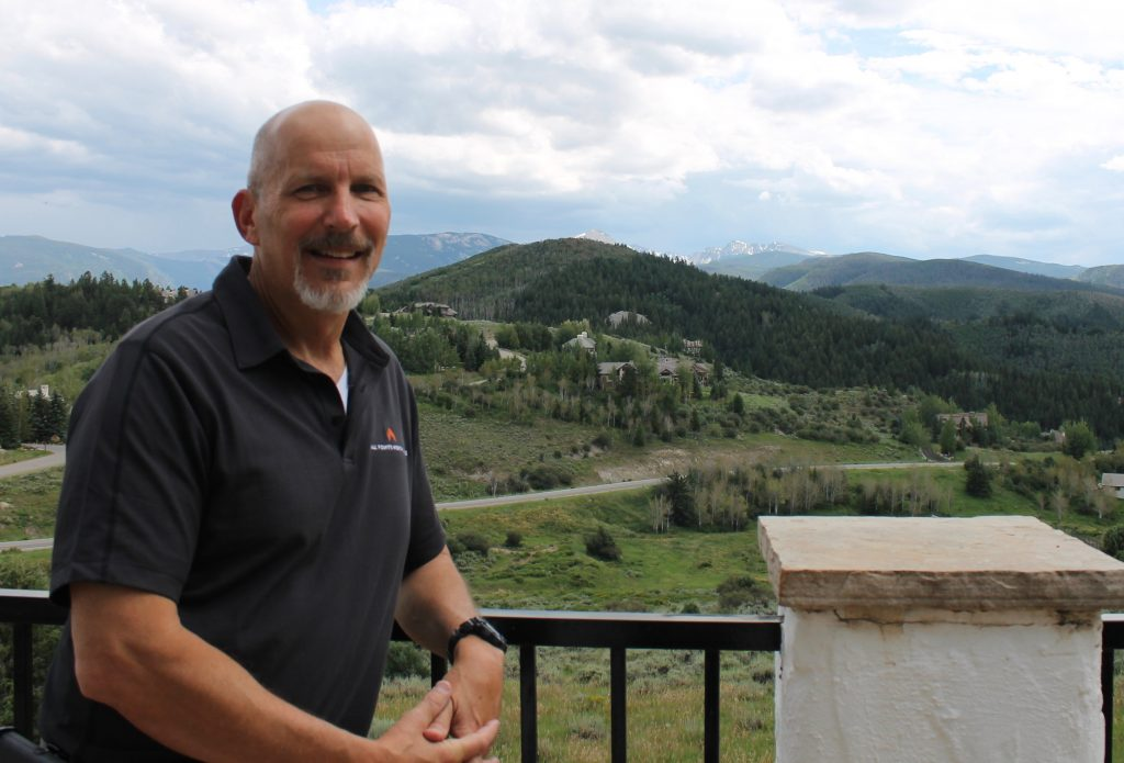 Jeff Brooks, Chief Operating Officer for All Points North Lodge takes in the expansive view from a deck at the Cordillera facility. The integrated behavioral health, wellness and addiction recovery program plans to open its residential treatment program this winter.
