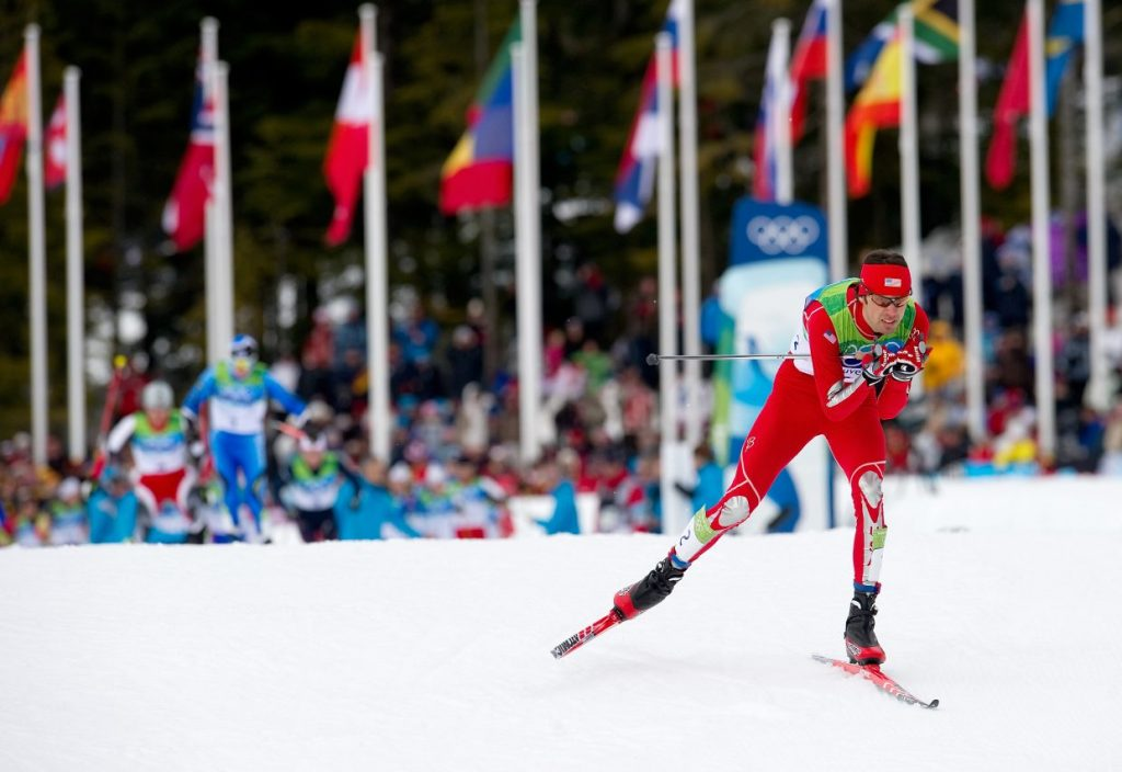 U.S. Nordic Combined Ski Team member Johnny Spillane races out of the start area of the 10-kilometer race in Thursday's individual large hill competition at Whistler Olympic Park. Spillane raced to silver in the event, and teammate Billy Demong brought home the gold. U.S. Nordic Combined Ski Team member Johnny Spillane races out of the start area of the 10-kilometer race in Thursday's individual large hill competition at Whistler Olympic Park. Spillane raced to silver in the event, and teammate Billy Demong brought home the gold.