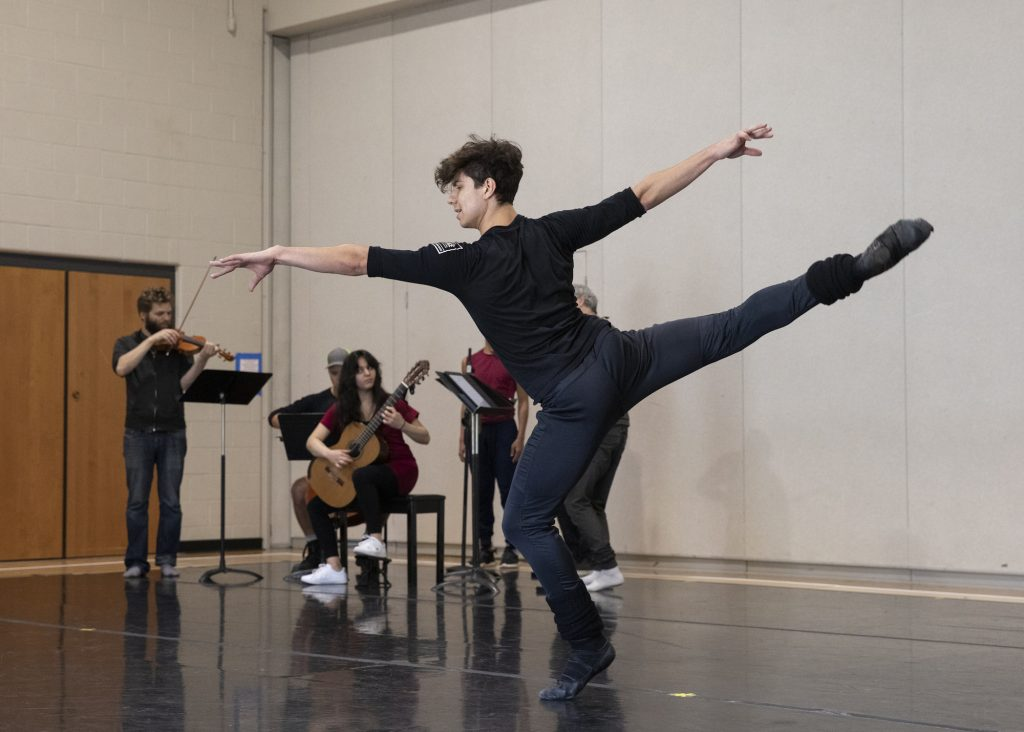 "Roman Mejia from the New York City Ballet rehearses his solo in ""Fandango"" at the Vail Mountain School on July 30 with string quartet Brooklyn Rider and guitarist Alberta Khoury in a new collaboration with choreographer Alexi Ratmansky."