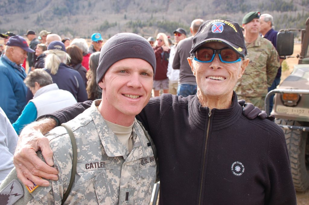 World War II 10th Mountain Division veteran Sandy Treat drops an arm around a current member of the 10th.