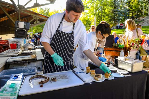 Mark Truszkowski, of Game Creek Restaurant, assembles lamb and foie gras sausage sliders during the Fall Wine & Food Classic Grand Tasting during the 2018 event at Gerald R. Ford Amphitheater.