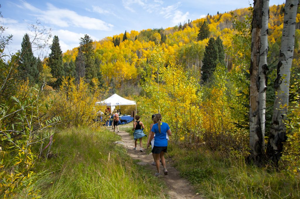 Hikers walk toward a food tent during the Hike Wine & Dine event in Beaver Creek. The annual event offers delicious food and drink along the trail and at the base of the Centennial Lift and is a benefit for the Shaw Cancer Center and Jack's Place, a cancer-caring house in Edwards.
