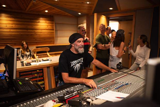 Engineer and Mad Dog Studios partner Ralph Pitt at work as guests from the Little Nell's Ride + Dine program look on.