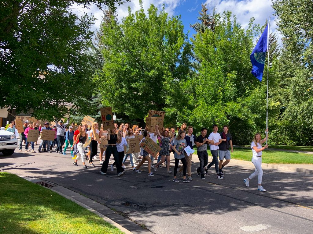 Vail Mountain School students march through Avon carrying signs during Friday's global climate strike.