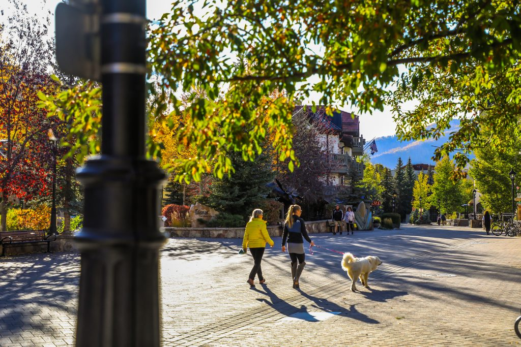 People stroll through the village Tuesday in Vail. Fall is up the up and downs with weather in the mountains.