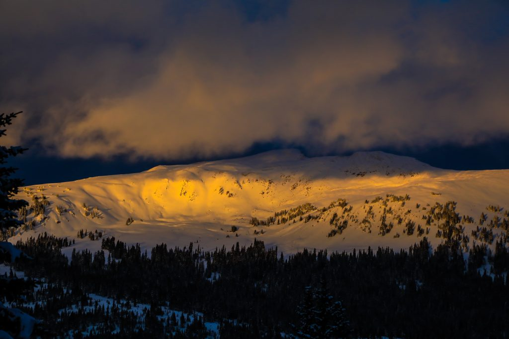 Alpen glow splashes the Gore Range Oct. 24 near Vail. New snow has blanketed the valley as more as expected through Wednesday.