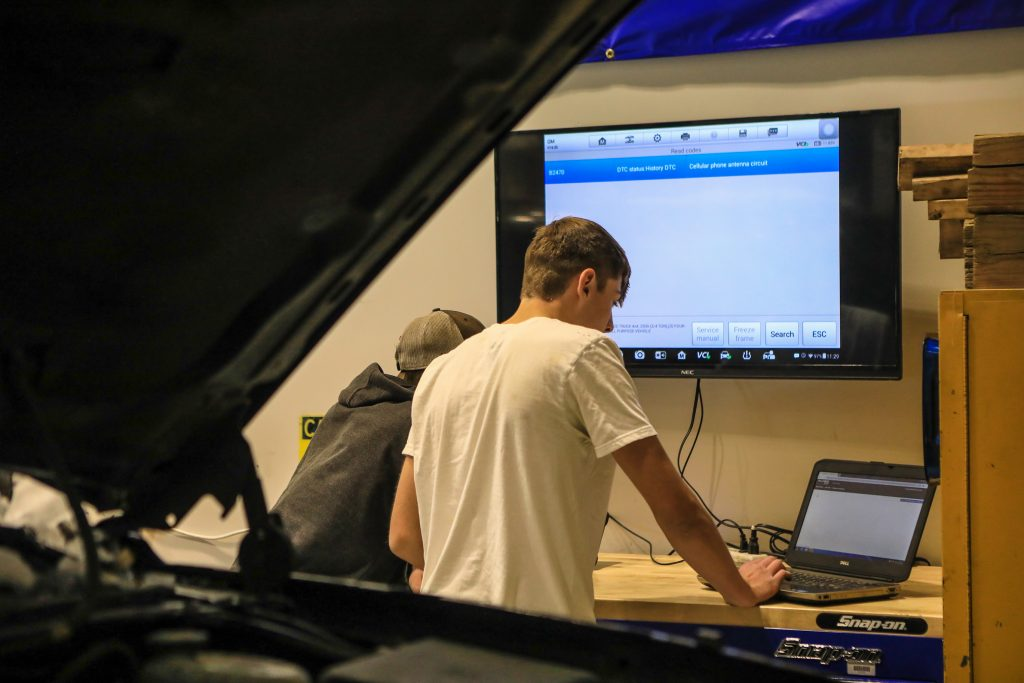 Michael Parker and Kyler Hill check real-time diagnostics at the Spring Creek Campus auto shop Wednesday, Oct. 30, in Gypsum. The advanced car repair software helps students better diagnose a problem in the vehicle.