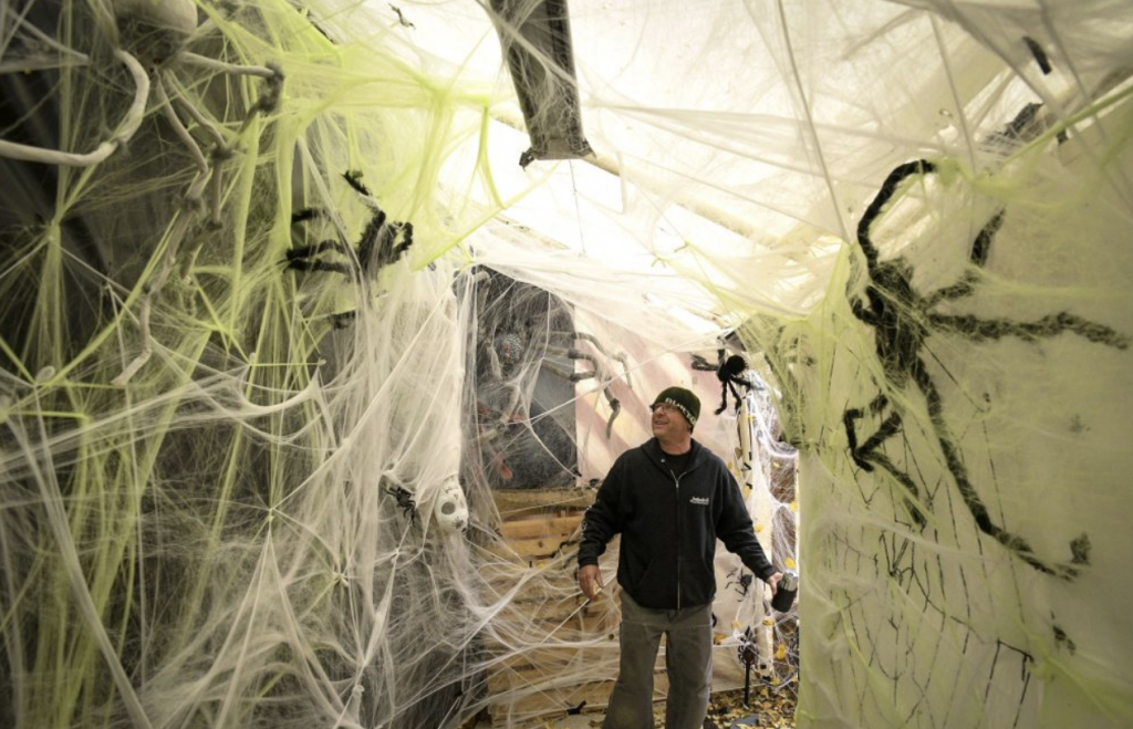 David Hall walks through the spider room, just a small part of the Halloween Haunted House he and his wife Katie have been hosting at the Rifle home for 17 years. (Kyle Mills / Citizen Telegram)