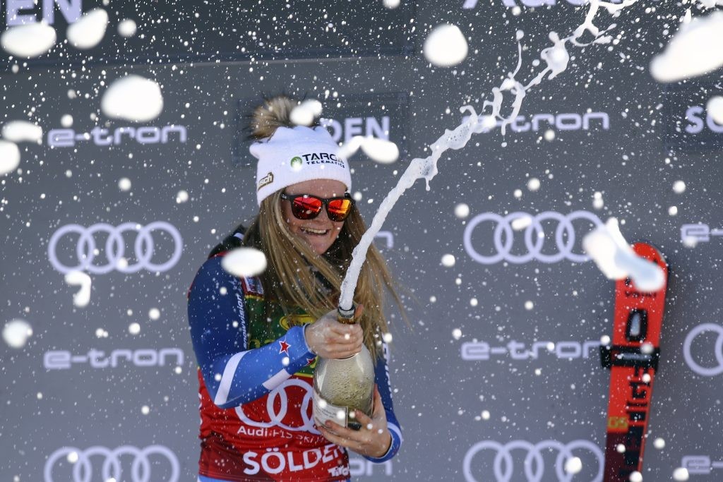 New Zealand's Alice Robinson celebrates on the podium after she won the Soelden, Austria, World Cup giant slalom on Saturday. She's the first New Zealander to win on tour since 1997.