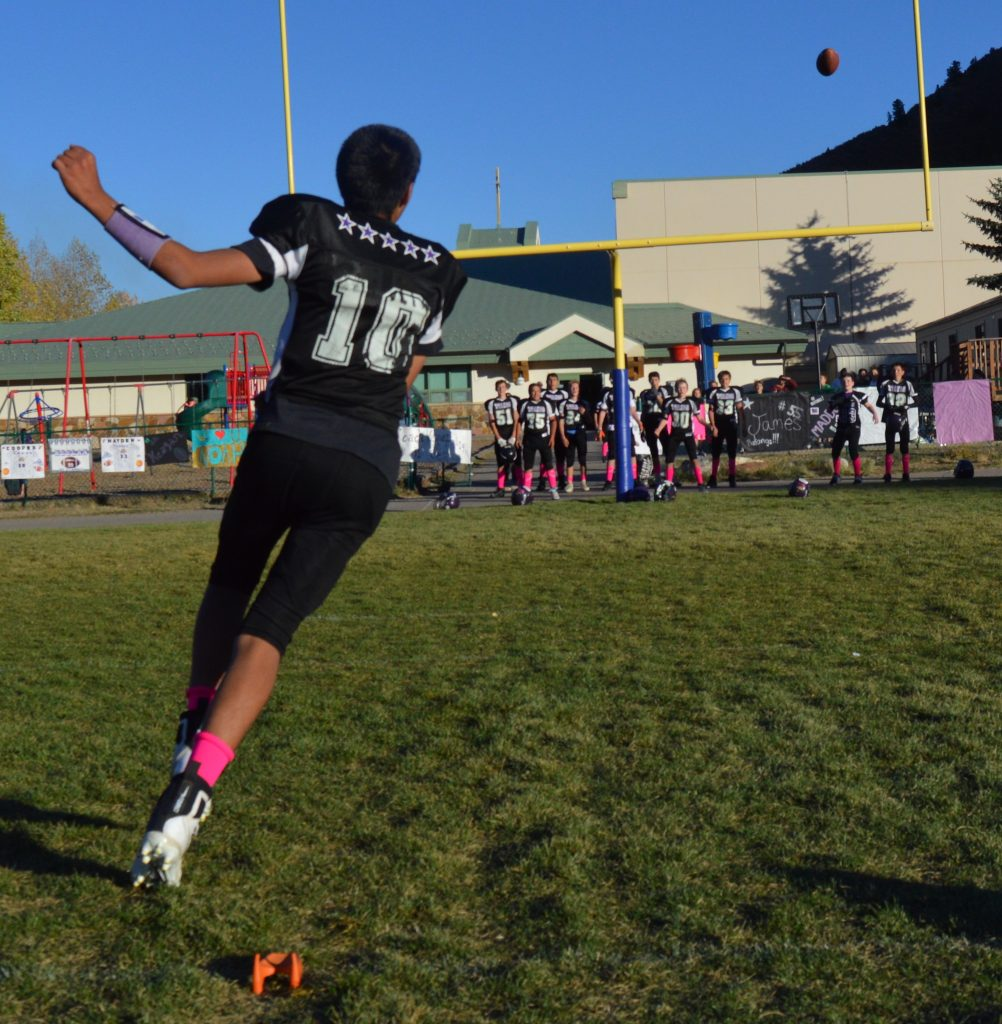 Elias Pena blasted three field goals during halftime of St. Clare's Kickin' Cancer football game, raising money for two families who are battling the disease.