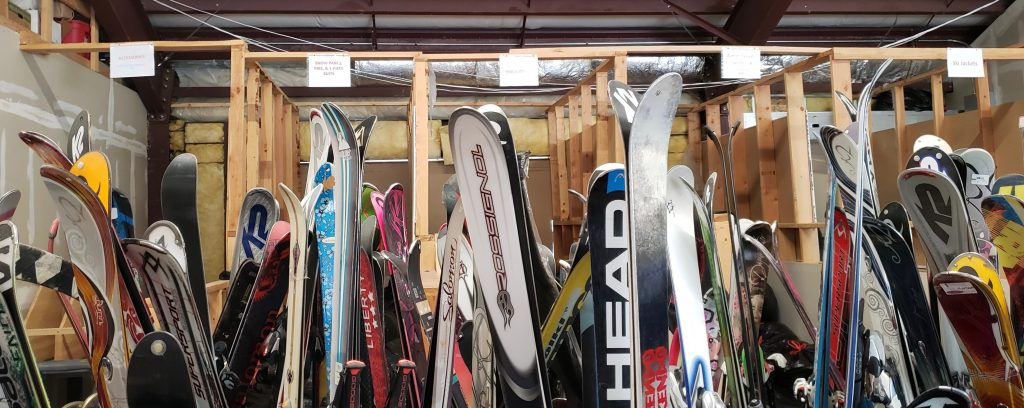 Stacks of skis will soon hit the Thrifty Shop sales floor. Vail Valley Cares Executive Director Greg Osteen hopes the equipment sells because