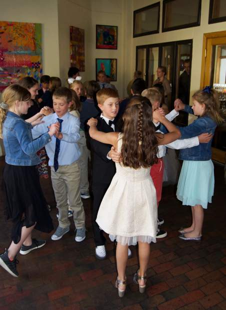 Rogan Isaacs and Annie Zurbay (center) dance the foxtrot along with other fifth graders during the Vail Ski & Snowboard cotillion graduation at La Tour Restaurant, as part of an enrichment offered through Vail Performing Arts Academy.