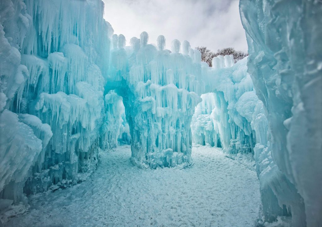 A combined 4,000 hours is spent dripping, shaping and hand-placing icicles for the Ice Castle. At the end, they're embedded with LED lights to create a colorful winterscape.