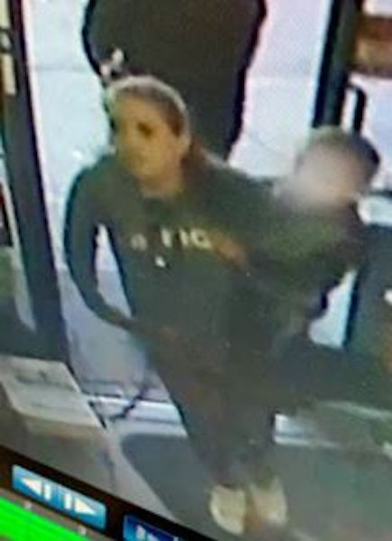 This woman is suspected of being with the man at the time of the robbery.