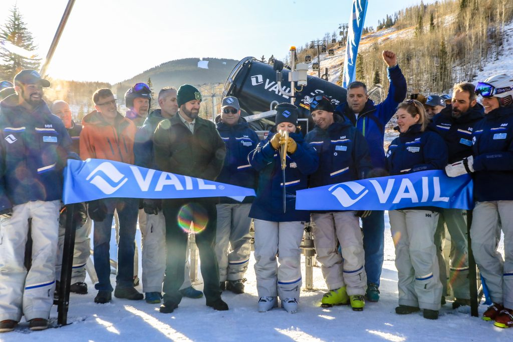 Vail Chief Operating Officer, Beth Howard, cuts the ribbon on opening day at Vail Friday near Gondola One. Vail was celebrating the largest snowmaking overhaul in the nation with new snowmaking guns.
