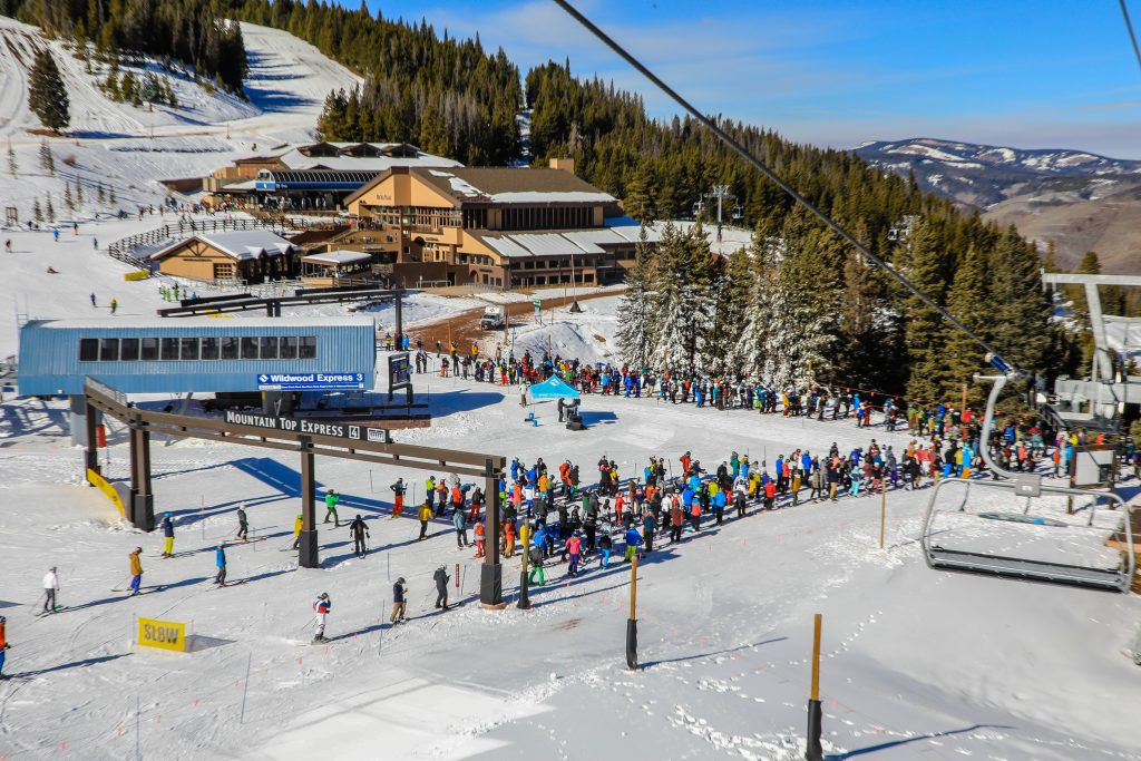 Crowds build during Vail's opening day Friday at MidVail. Vail will open more terrain as weather permits.