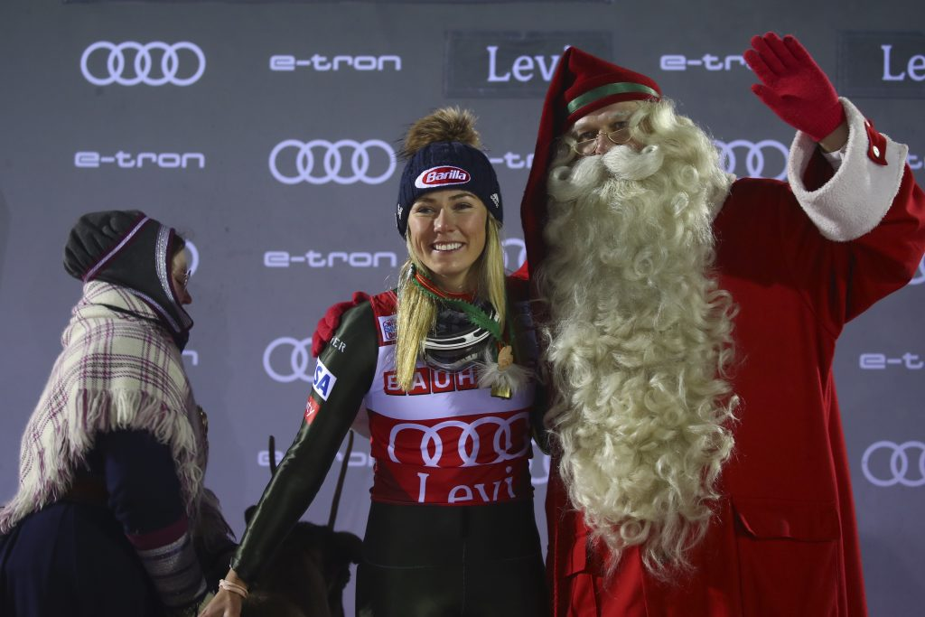 United States' Mikaela Shiffrin poses with Santa Claus during the podium ceremony after winning an alpine ski, women's slalom in Levi, Finland, Saturday, Nov. 23, 2019. (AP Photo/Alessandro Trovati)