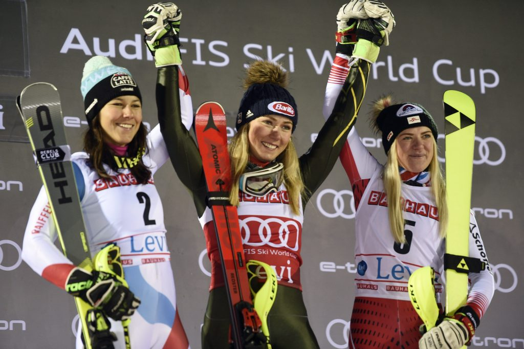 United States' Mikaela Shiffrin,center, winner of an alpine ski, women's slalom, celebrates with second-placed Switzerland's Wendy Holdener, left, and third-placed Austria's Katharina Truppe, in Levi, Finland, Saturday, Nov. 23, 2019. (Martti Kainulainen/Lehtikuva via AP)