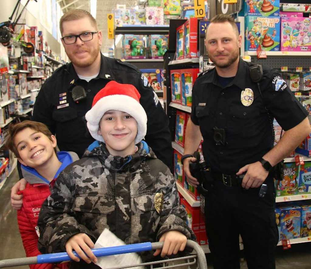 For Shop With a Cop, kids are paired with local cops and sent shopping.