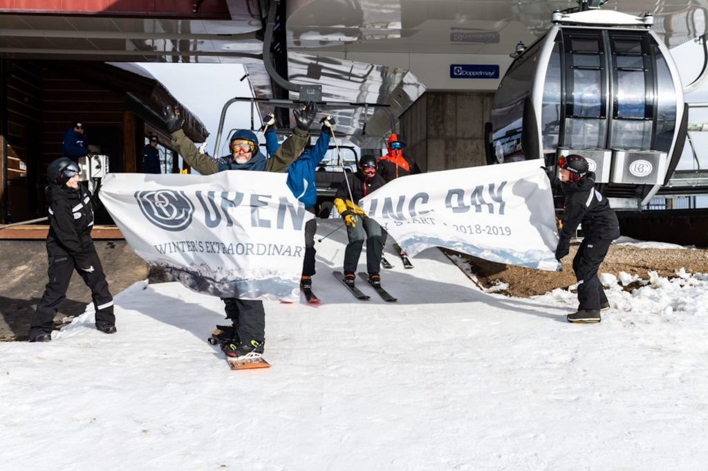 Excited skiers and riders bust through the banner during the 2018-2019 Opening Day at Beaver Creek. Beaver Creek will open four days ahead of schedule with 70 acres of terrain on Saturday.