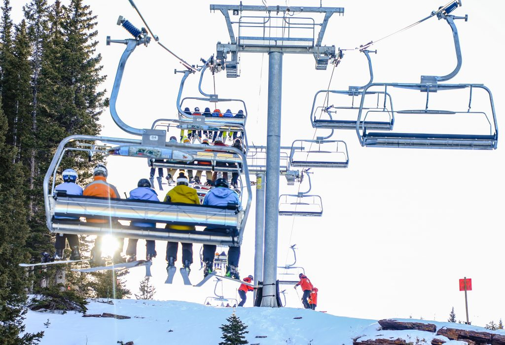 Skiers and riders head up the mountain on Opening Day at Vail.