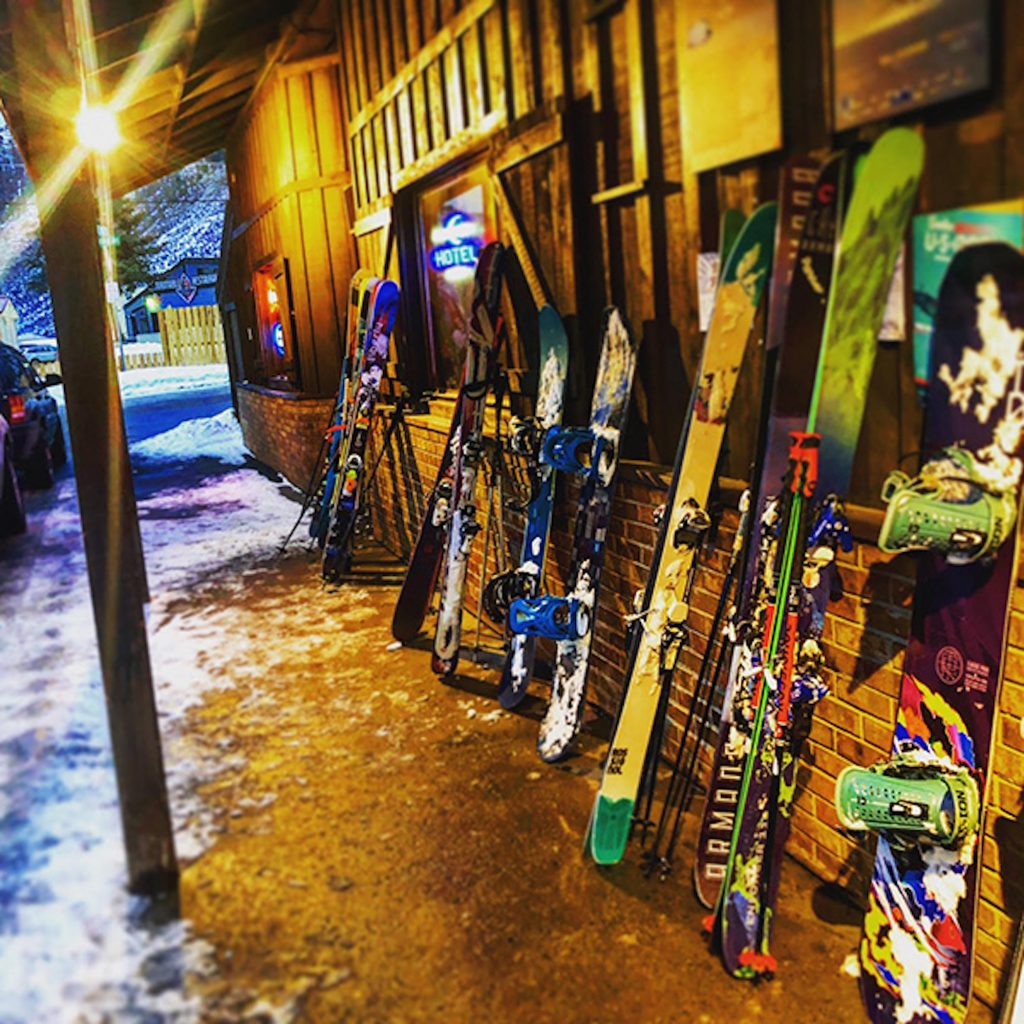 Skis and boards line the side of The Minturn Saloon, the final stop on The Minturn Mile.