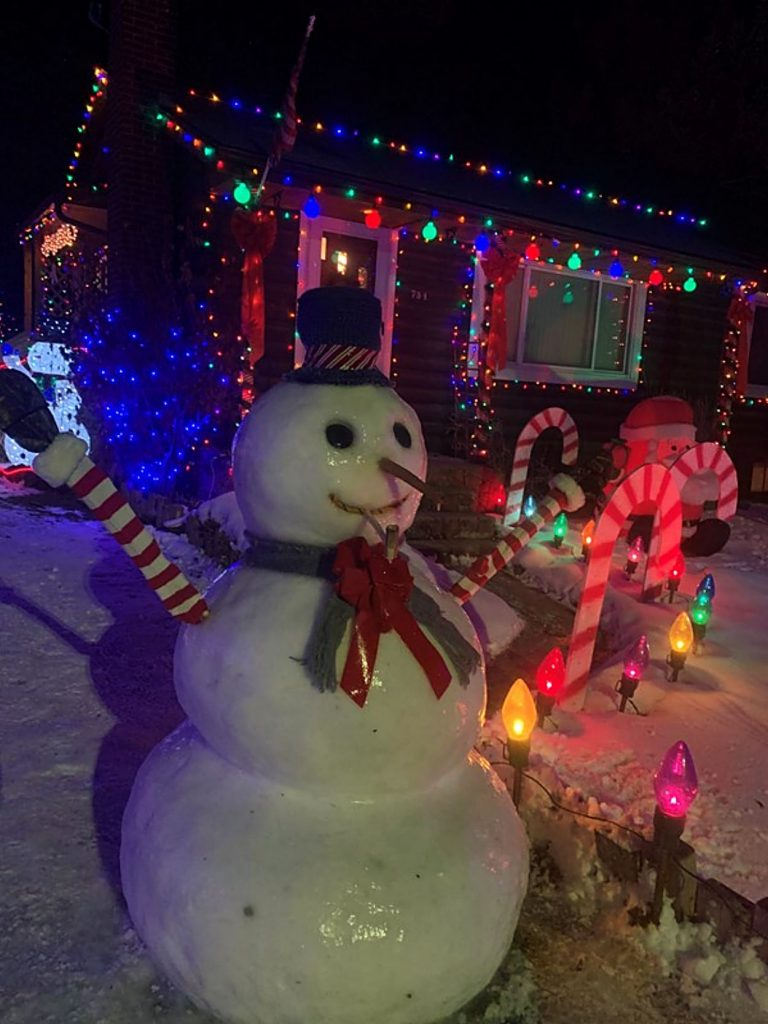 "These readers built a picture-perfect snowman, and wrote ""staying with us through Christmas thanks to a wet snowstorm and Woody's topcoat."""