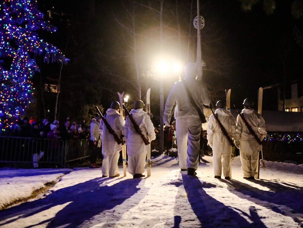 Military veterans pose in front of the 10th Mountain Division statue and memorial during the 10th Mountain Legacy Parade in Vail. The ski down and parade will run through Vail Village and guests can learn more about the division's contributions to military and ski history at the Colorado Snowsports Museum, which will be open after-hours.