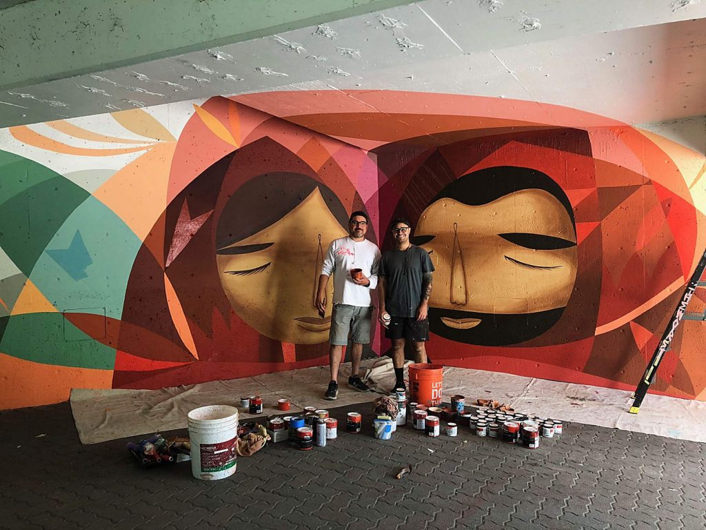 Denver's Pedro Barrios and Jamie Molina stand with their nearly completed mural on the Lionshead parking structure in Vail. The mural was comissioned as part of the Art in Public Places initiative, which aims to beautify the town with art from Colorado artists. The artists wrapped up their project in July 2019.