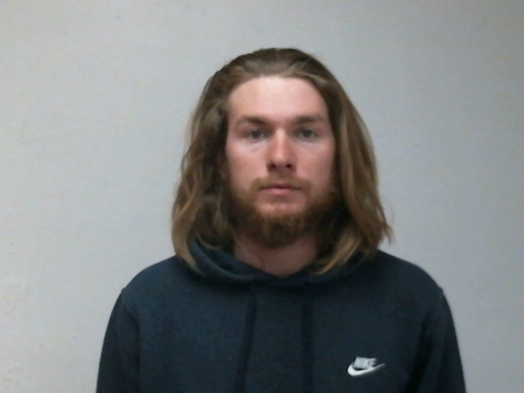 Andrew Reynolds surrendered to Vail police Friday evening in connection with a New Year's Day assault in Vail that left a man hospitalized.