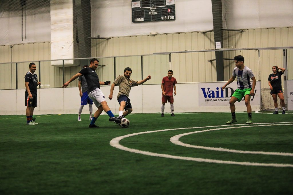 Local soccer legend Cesar Castilla, brown shirt, and Mario Vargas mix it up during a Freedom FC practice. The professional arena soccer team opens its season at noon Saturday in the Mountain Rec Edwards fieldhouse.