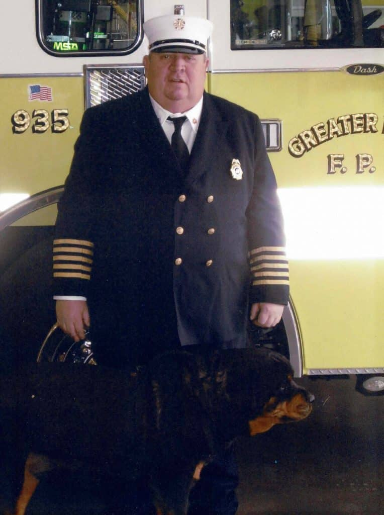 Greater Eagle Fire Protection District Chief Jon Asper and his beloved Bear.