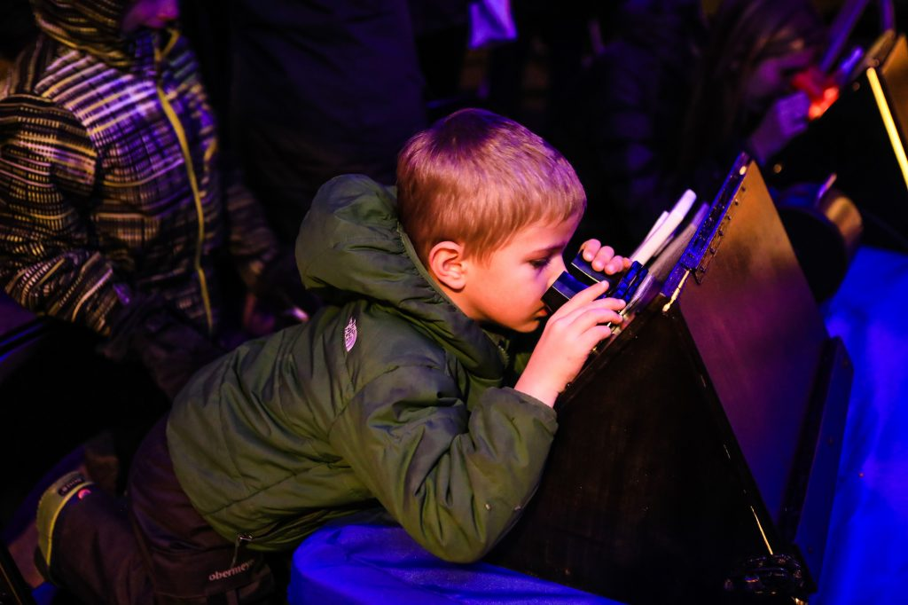 Eli Causey, 4, of Eagle checks out an almost-100-year-old view of space slides during the Vail Astronomy Nights in Vail on Nov. 24.