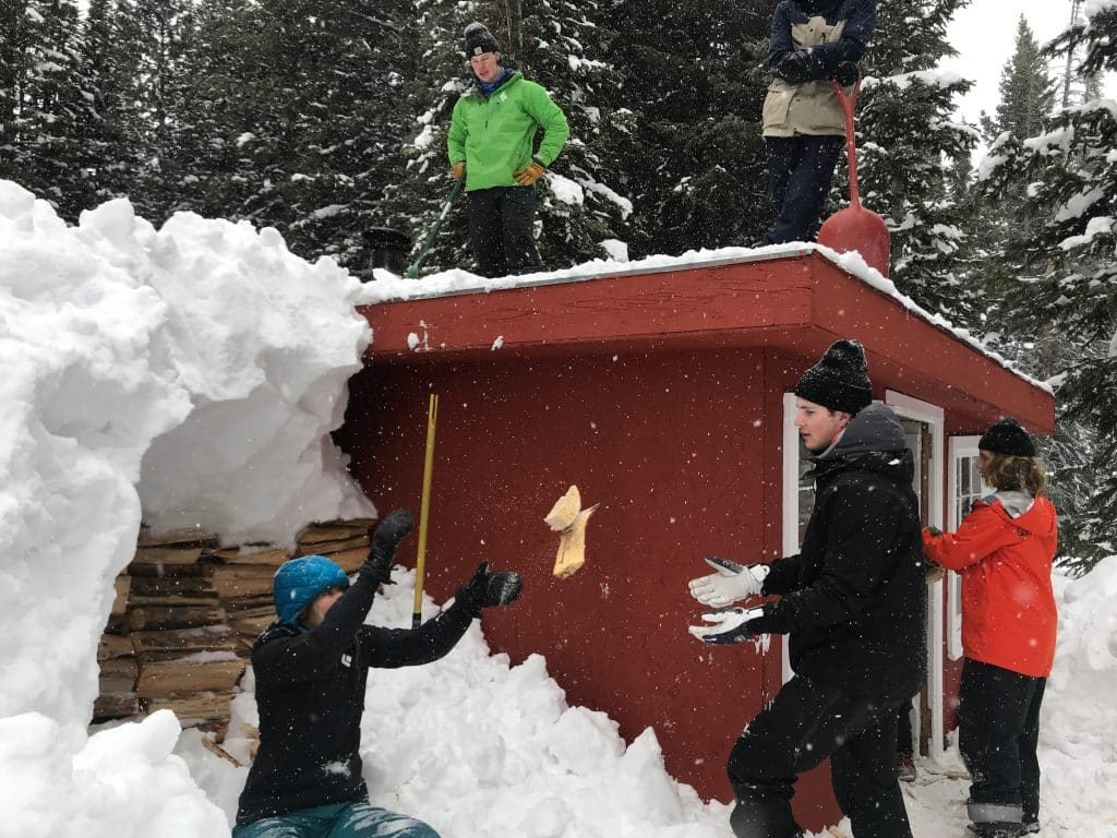 Older Vail Mountain School students took a trek to a 10th Mountain Division Hut where they cleared snow off the roof and stacked firewood.