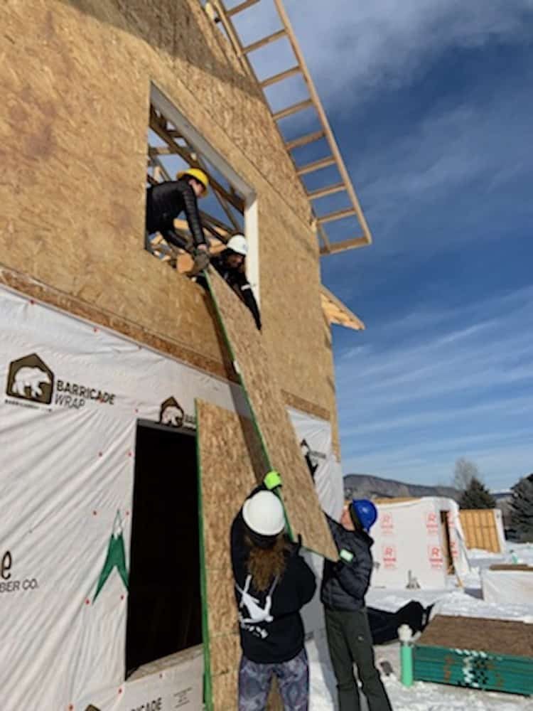 VMS students lifted sheets of plywood into place Monday at a Habitat for Humanity site in Gypsum.
