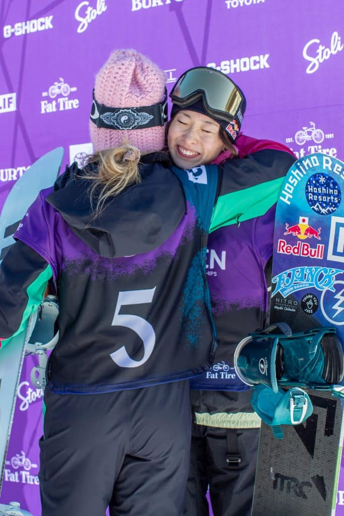 Jamie Anderson and Miyabi Onitsuka share a hug while walking to the podium after the Burton US Open Slopestyle Finals. Anderson placed 1st and Onitsuka placed 3rd.