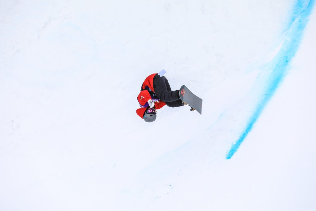 Kwang Ki Lee nollie front flips in the pipe during the mens halfpipe semifinals for the Burton US Open in Vail.