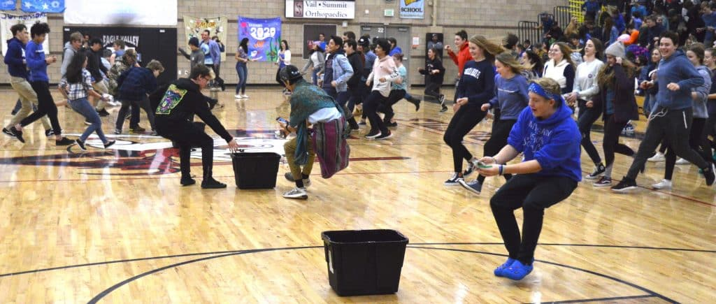 Students stormed the floor to put money in bins as Eagle Valley kicked off Wish Week.