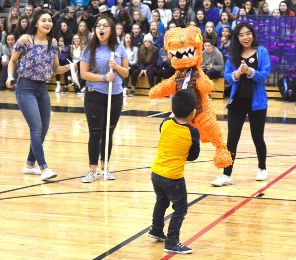 That pinata is full of money raised by Eagle Valley students, and that's Rehan Fernandez smacking it with a lacross stick. The money will help make Rehan's wish for a trip to Florida's Universal Studios theme park come true through Make-A-Wish Colorado.