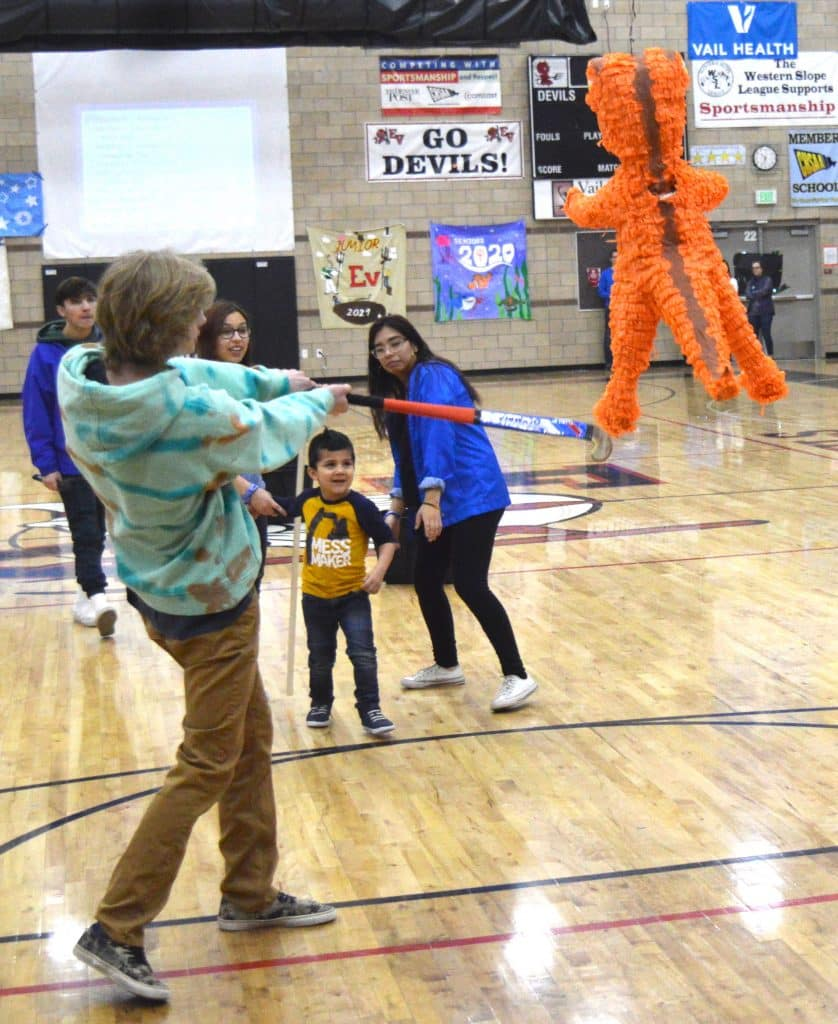 Sometimes we all need a little help and Eagle Valley senior Billy Johnson helped Rehan Fernandez break open a pinata full of money. The money, some of the thousands of dollars raised by Eagle Valley students, will help Make-A-Wish Colorado send Rehan to Florida's Universal Studios theme park.