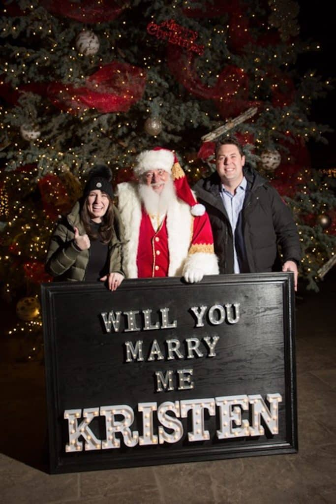 Chris got Kristen into the holiday spirit by proposing at a tree lighting with the help of Santa.