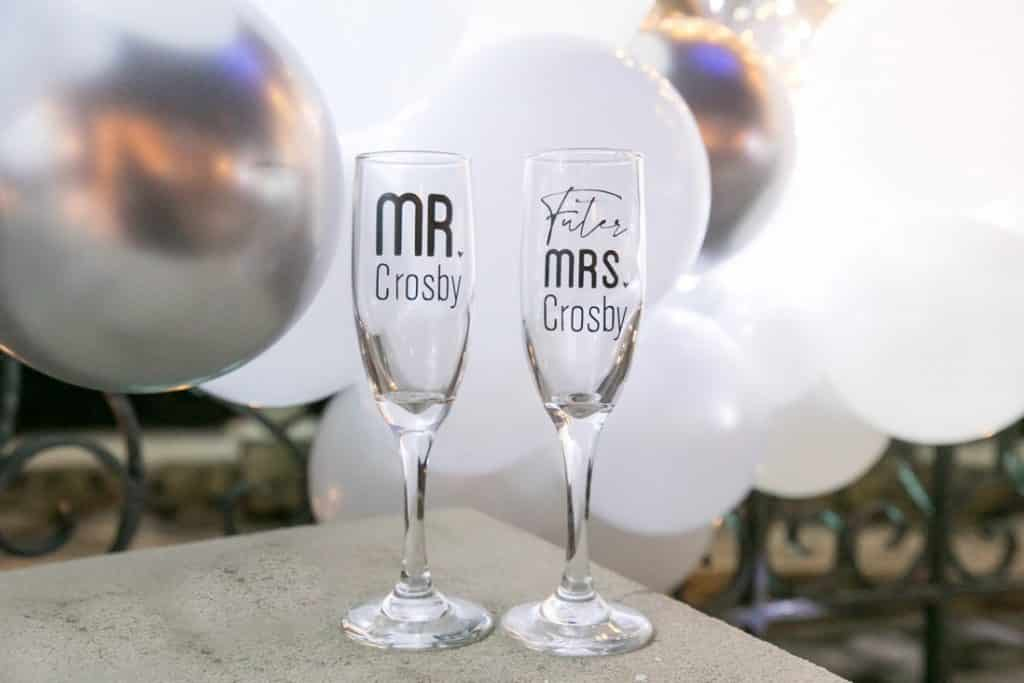 "Fleck says ""more is more"" and handles all the details, including these personalized champagne glasses for the couple to use during the proposal."