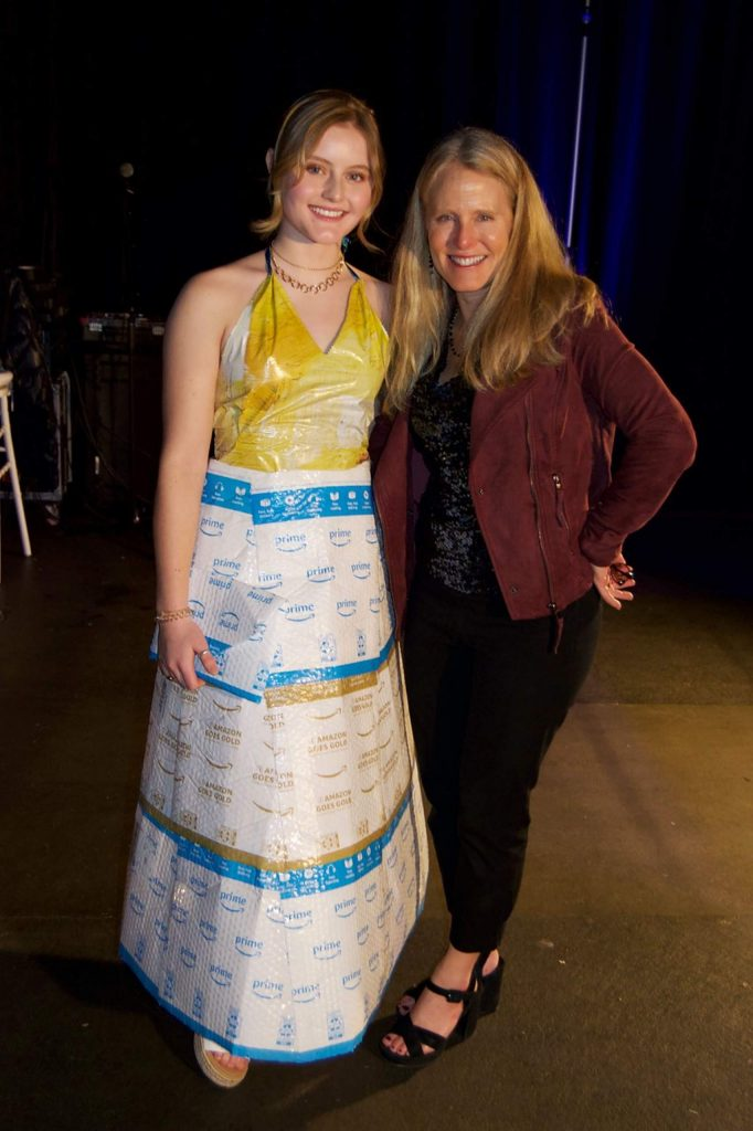 Addie Maurer models a dress made of Amazon Prime shipping envelopes, designed by her mother, Dana.